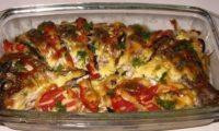 Карп с овощами, запеченный в духовке